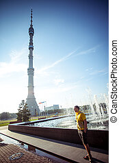 Man stands at Ostankino TV tower in Moscow