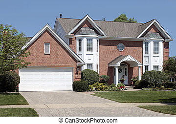 Brick home with columns in entryway - Brick home in suburbs...