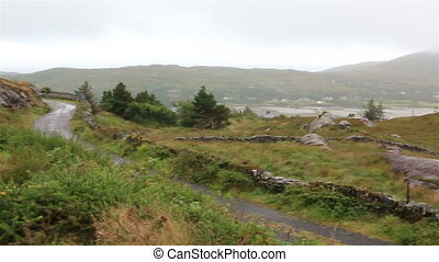 Panorama of mountains and green valleys. Ring of Kerry in...