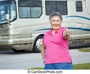RV Senior Woman - Thumbs Up - Happy senior woman standing in...