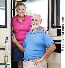 RV Seniors in the Doorway - Senior couple posing in the...