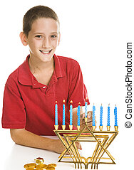 Boy Celebrating Hanukkah - Little boy celebrates Chanukah by...