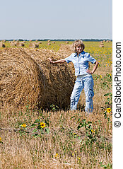 Haystack and girl