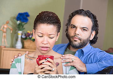 Worried Hispanic Couple