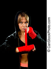 young sexy dangerous boxing girl wrapping hands and wrists...