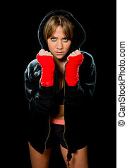 young sexy boxing girl with wrapped hands and wrists in...