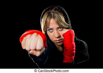 young sexy dangerous girl shadow boxing with wrapped hands...
