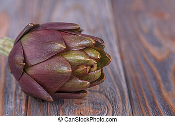 Fresh artichoke - Fresh ripe artichoke on a wooden...