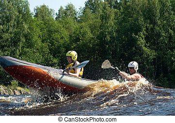Kayak on river - Kayakers sporting a kayak cuts through...