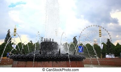 Ferris wheel behind fountain in Moscow, Russia. HD....