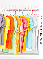clothes line - Multi-colored T-shirts hanging on a clothes...