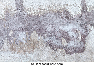 Old white concrete wall. Paint peeling off the walls.