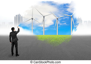 Businessman spraying wind turbines paint covered gray...