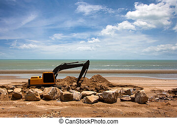 excavator machine doing earthmoving work at sand quarry