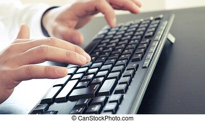man typing on a pc keyboard