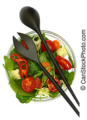 Bowl of fresh colorful salad with fork and spoon isolated