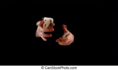 Unusual playing card trick on black background