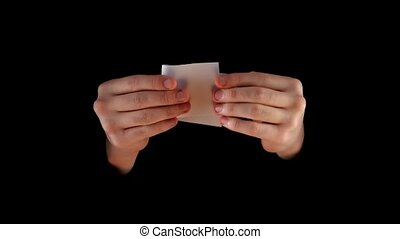 Magician shows trick with money on black background -...