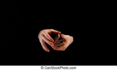 Magic playing card trick on black background