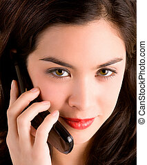Beautiful Woman Using her Cell Phone - A beautiful girl is...