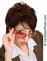 Beautiful Brunette Looking Over Sunglasses - Close-up of a...