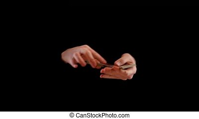 Playing cards trick making by magician known as kardistri on...