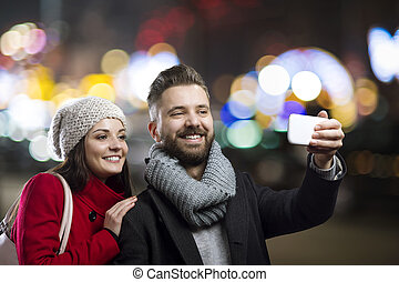 Couple in the city - Trendy young hipster couple enjoying...