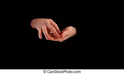 Magician making performance with aces on black background -...