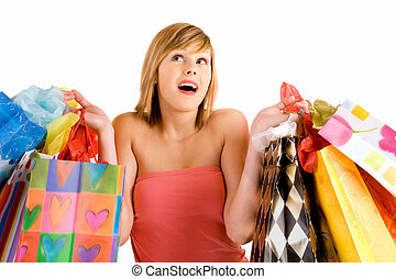 Young Woman on a Shopping Spree - A proud young woman is...