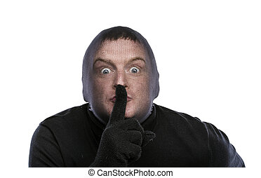Thief in balaclava making funny faces, dressed in black....