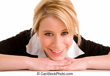 Blonde Smiling Woman Laying on her Desk
