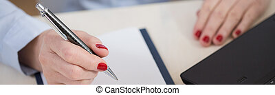 Making out the documents - Close-up of aged businesswoman...