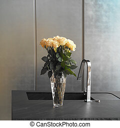 Vase in a Kitchen - Kitchen sink and vase with roses, square...