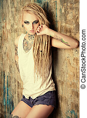 manga style - Modern girl with blonde dreadlocks. Jeans...