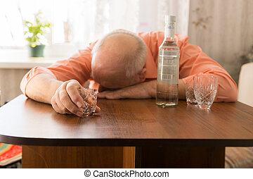 Drunk Old Man Leaning on the Table Holding a Glass - Close...