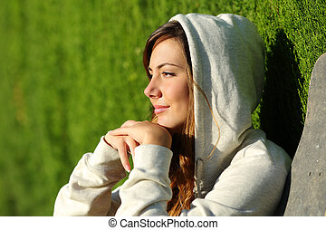 Side view portrait of a pensive teenager skater girl...