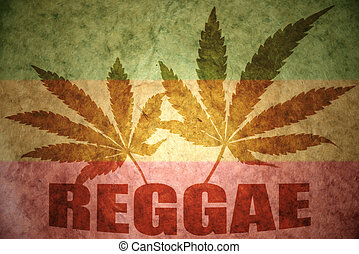 Reggae - text reggae with cannabis leafs on a vintage...