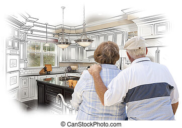 Senior Couple Looking Over Custom Kitchen Design Drawing and...