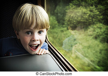 Excited boy on steam train in England