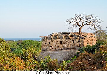 Ancient ruins at the coast of Mamallapuram, India - Ancient...