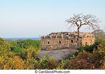 Ancient ruins at the coast of Mamallapuram, India - Ancient...