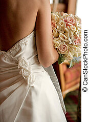 Back view of a bride - A back view of a bride with her...