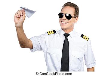 Passionate about his job. Confident male pilot in uniform...