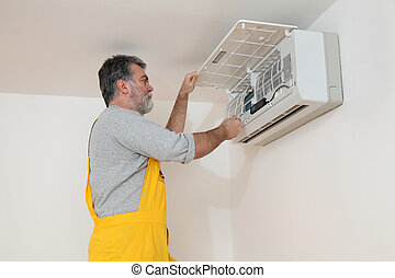 Air condition examine or install - Electrician cleaning...