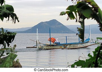 Boat on Taal lake in front of Volcano, Philippines - Boat on...