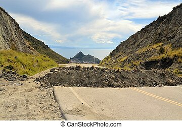 Political Road Block of rock and debris in Bolivia - Road at...