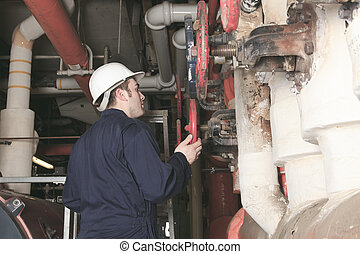 maintenance engineer checking technical data of heating...