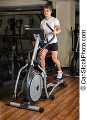 Man's Workout On Elliptical Machine - Man Working Out On...