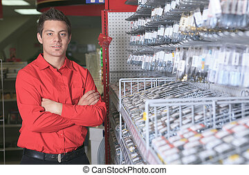 Hardware store employee - A employee of a hardware store at...