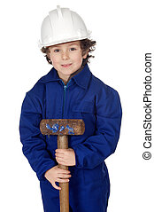 Adorable boy dressed worker in a hammer and a helmet a over...